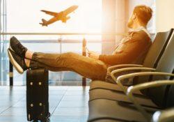 man at airport waiting for flight