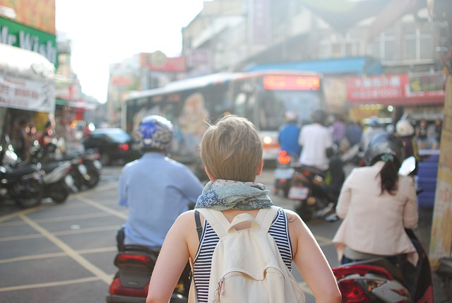 woman traveling wearing backpack