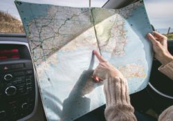 looking at a map on a road trip