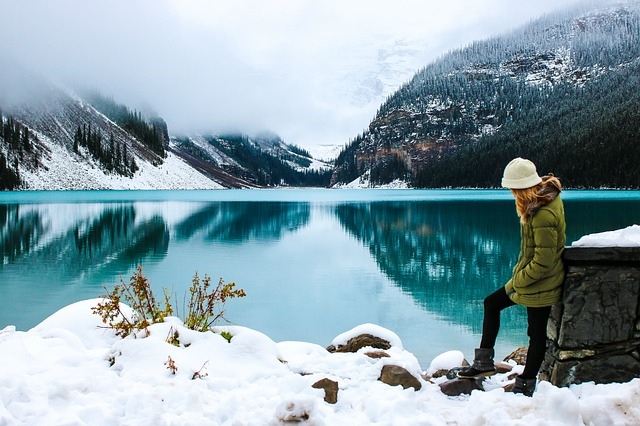 woman at lake in the winter