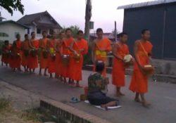 tak bat Laos